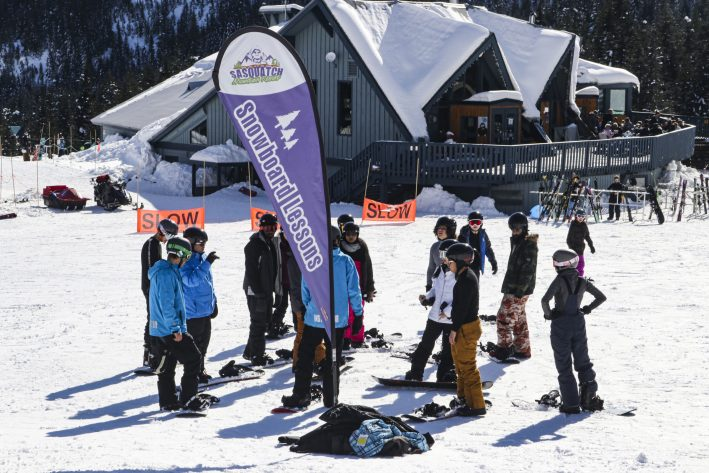 Instructors and guests gathered for skiing and snowboarding lessons at Sasquatch Mountain Resort