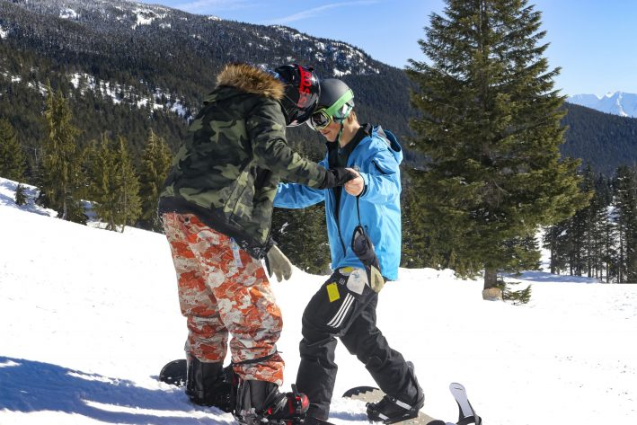 Instructor teaching a snowboard lesson at Sasquatch Mountain