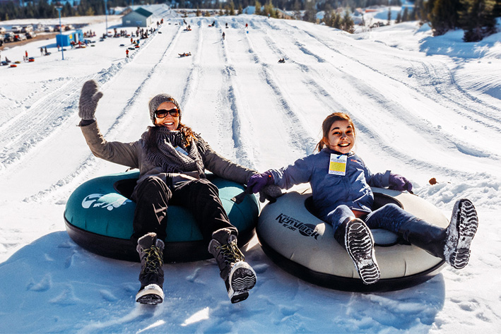 Mom and daughter snow tubing at Sasquatch Mountain