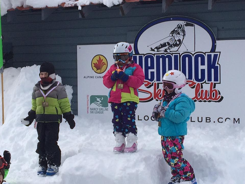 Three young members of the ski club pose for photo at Sasquatch Mountain