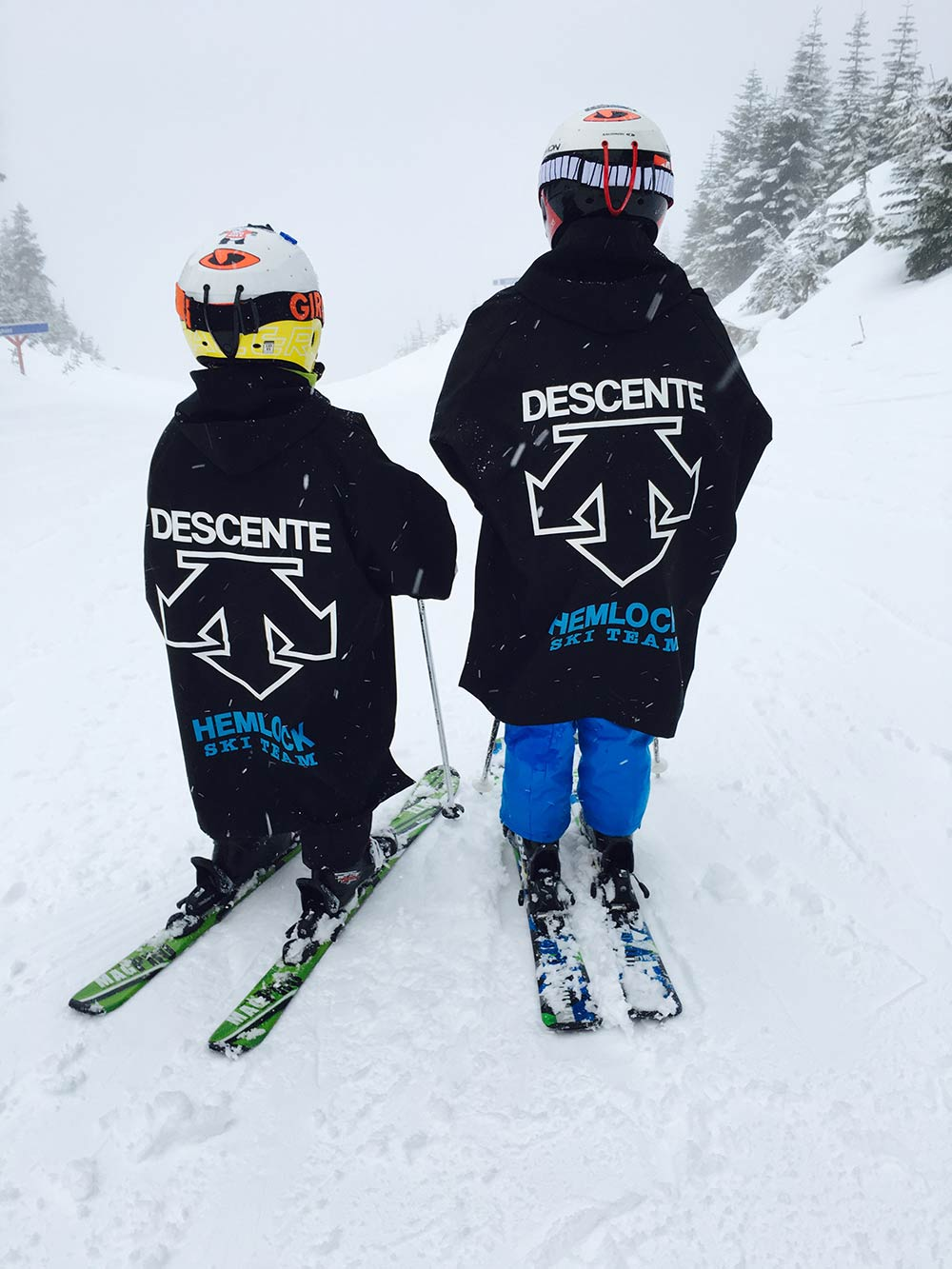 Two young ski club members on skis at Sasquatch Mountain