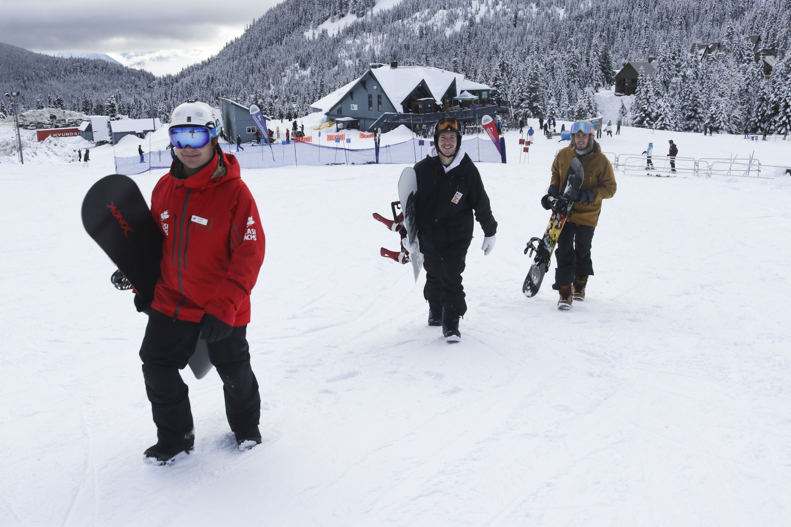 Walking with snowboards in snow at Sasquatch Mountain Resort
