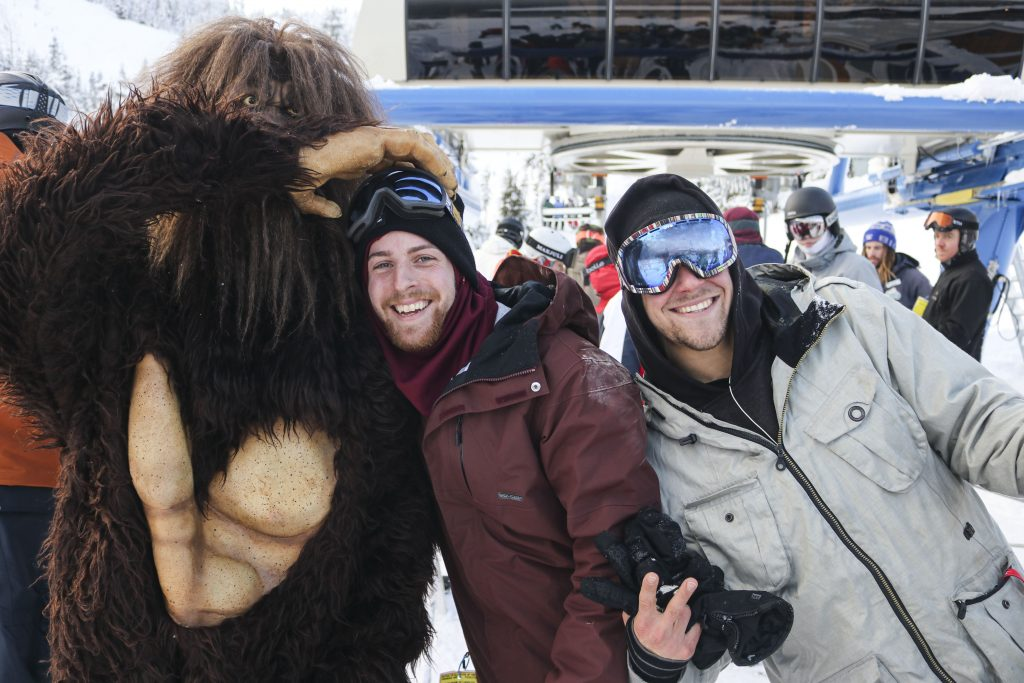 Two guests posing with our Sasquatch mascot in front of Yeti Cruiser Quad