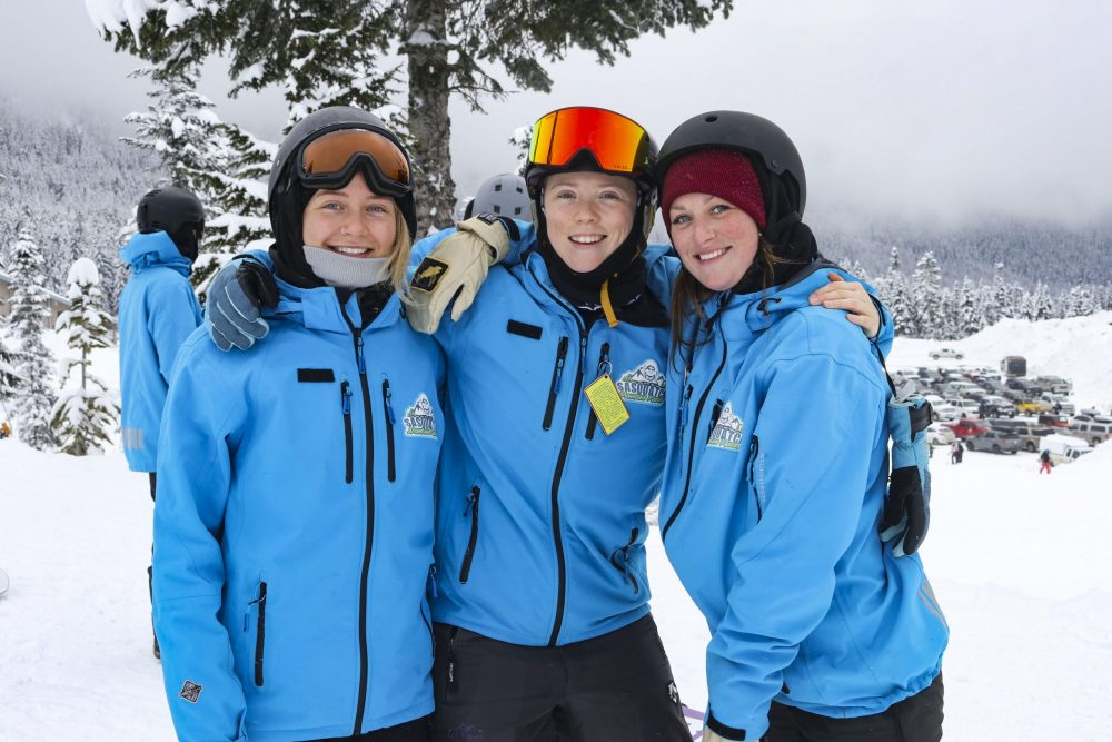 Three ski and snowboard instructors at Sasquatch Mountain