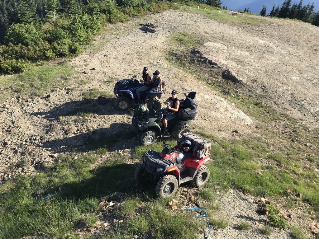 Three people on ATV's while camping at Sasquatch Mountain Resort