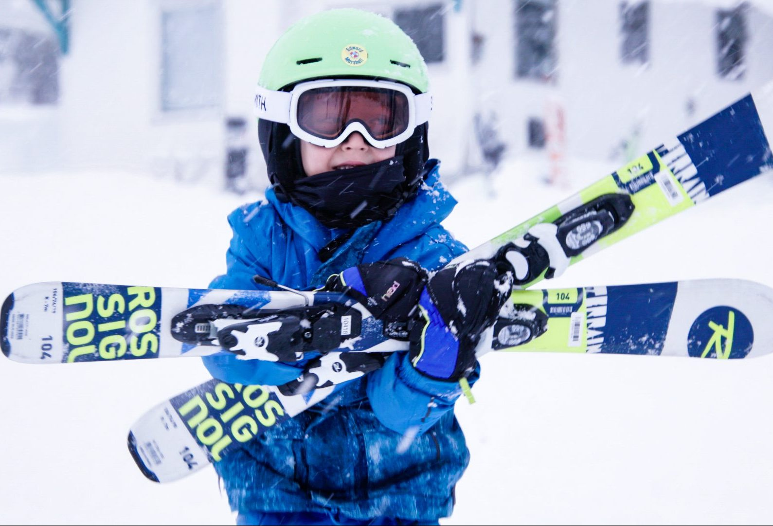 child carrying skis at Sasquatch Mountain Resort