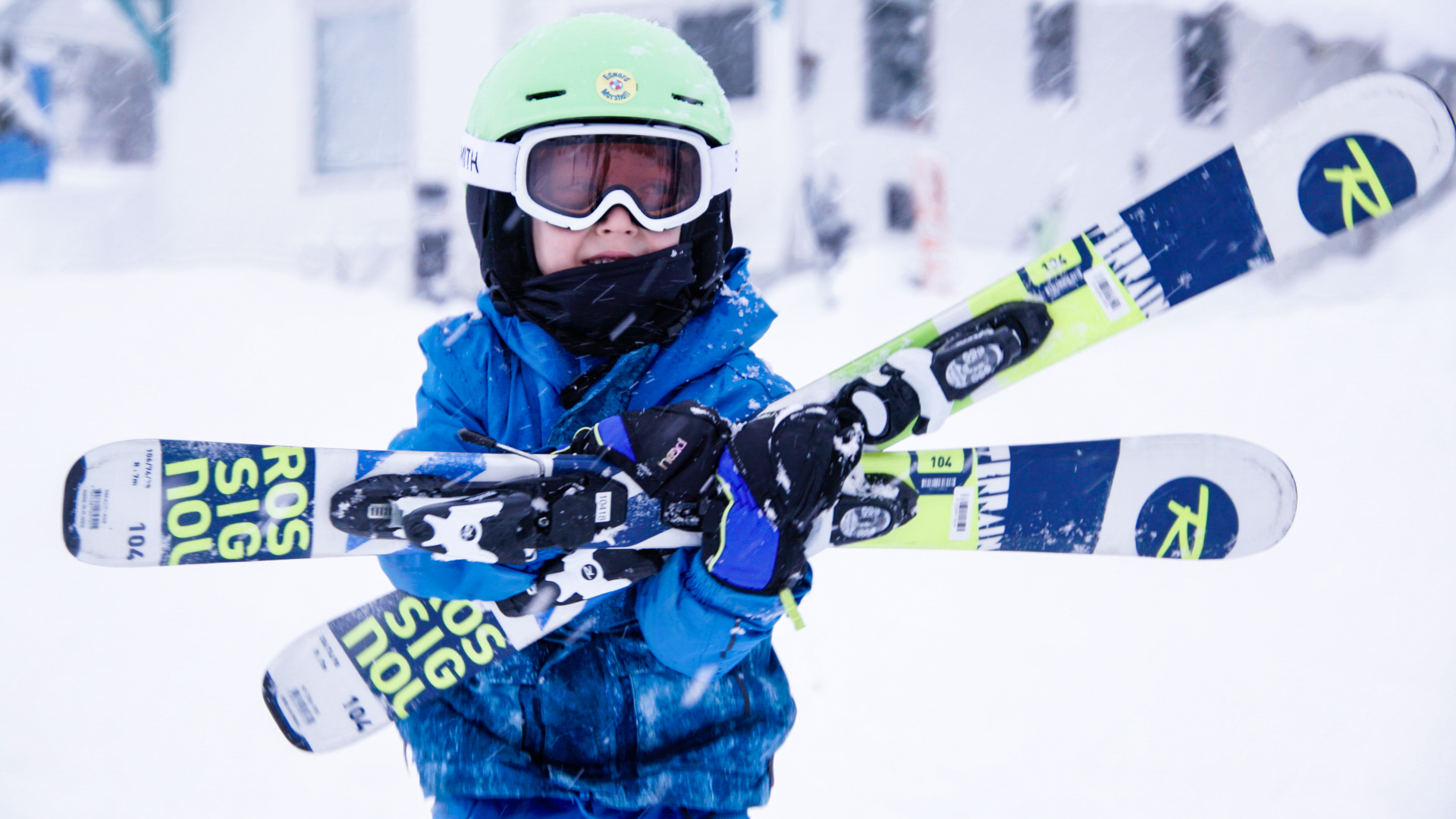 child carrying skis at Sasquatch Mountain Resort